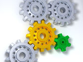 Silver, gold and green gears — Stock Photo