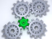 Silver and green gears — Stock Photo