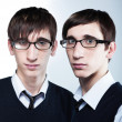 Stock Photo: Cute young twins with fashion haircuts