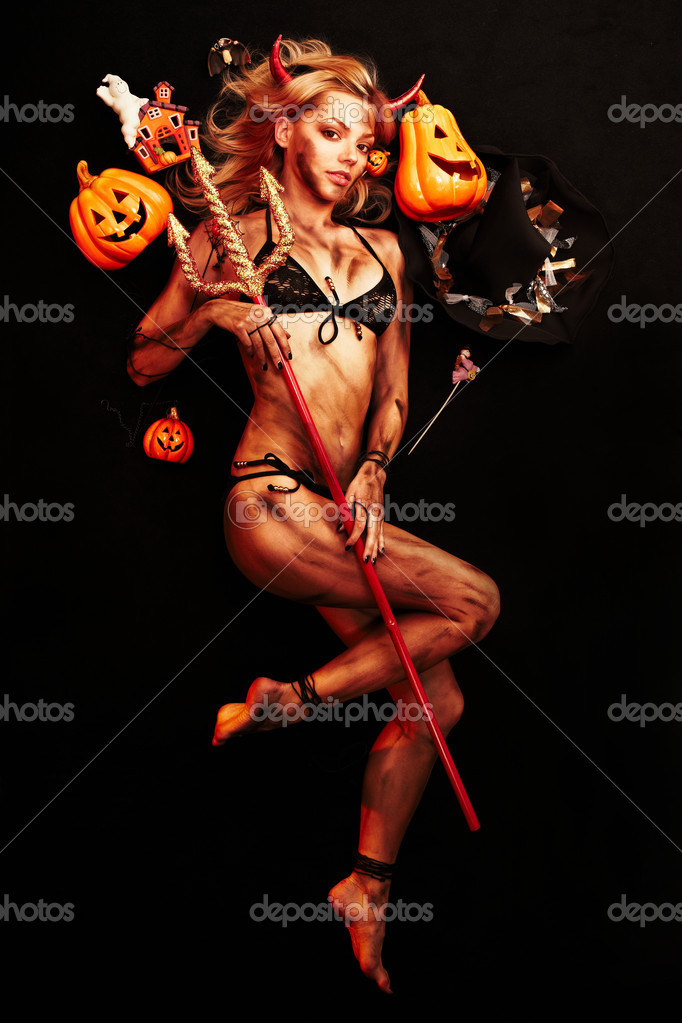 Beautiful devil with trident and Halloween accessories on black — Stock fotografie #1832034