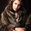 Romantic girl wearing furs — Stock Photo