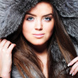 Stock Photo: Beautiful girl wearing fur coat