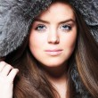 Beautiful girl wearing fur coat — Stock Photo #1869368