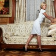 Attractive maid making a sofa in  hotel - Stock Photo