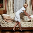 Attractive maid making a sofa in hotel — Stock Photo #1869409