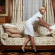Stock Photo: Attractive maid making a sofa in hotel