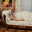 Attractive maid making a sofa in hotel — Stock Photo #1869424