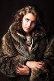 Romantic girl wearing furs — Stock Photo