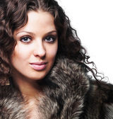 Beautiful woman wearing furs — Stock Photo