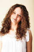 Curly-headed smiling girl — Stock Photo