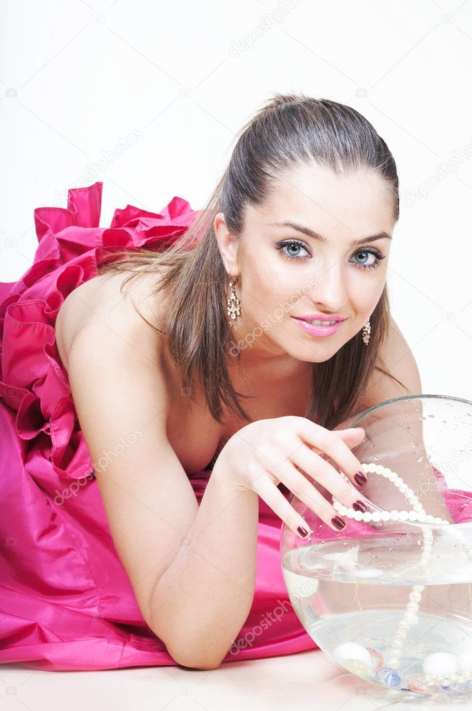 Beautiful young woman taking an aquarium — Stock Photo #1869295