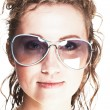 Cute young woman wearing sunglasses — Stock Photo