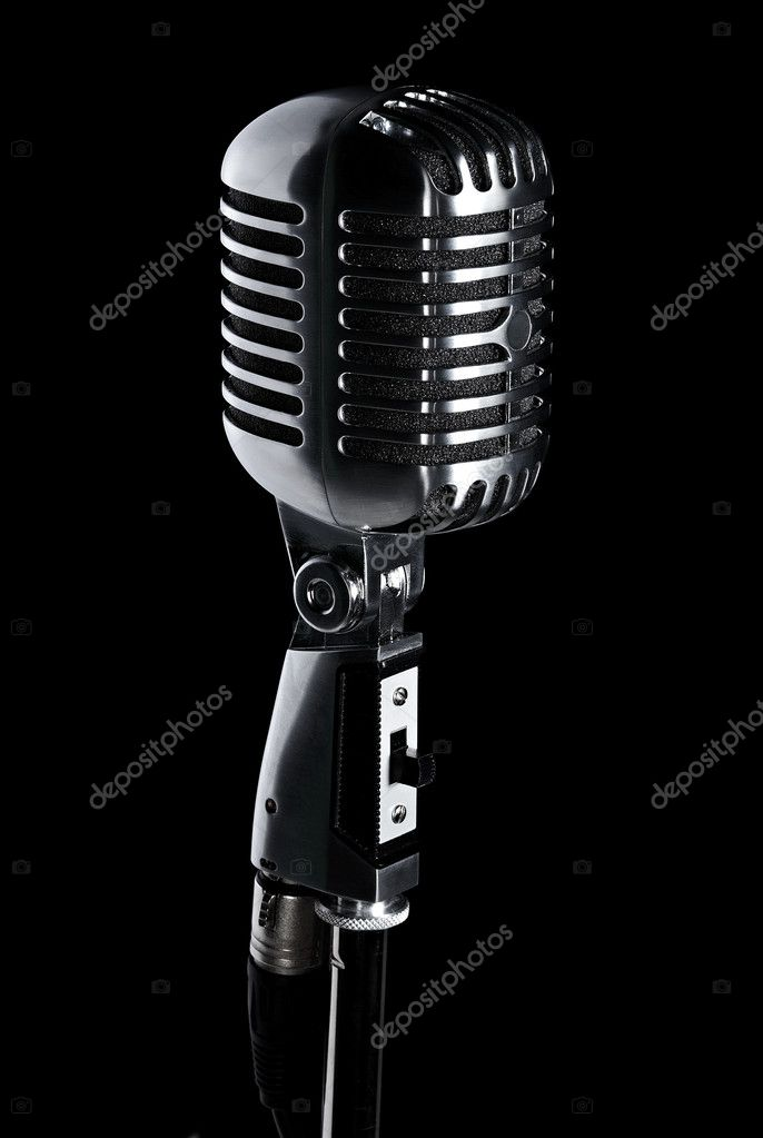 Retro microphone on stand isolated on black — Stock Photo #1888905