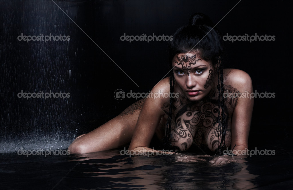 Beautiful model with bodypainting in water on black  Stock Photo #1889054
