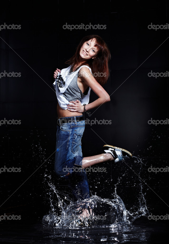 Cute Young woman dancing in water — Stock Photo #1889087