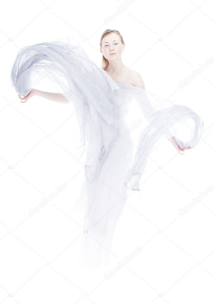 Young woman waving by light fabric over white high key — Lizenzfreies Foto #1889091