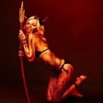Beautiful vampire devil with trident — Stock Photo