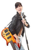 Rock-n-roll girl holding a guitar — Stock Photo