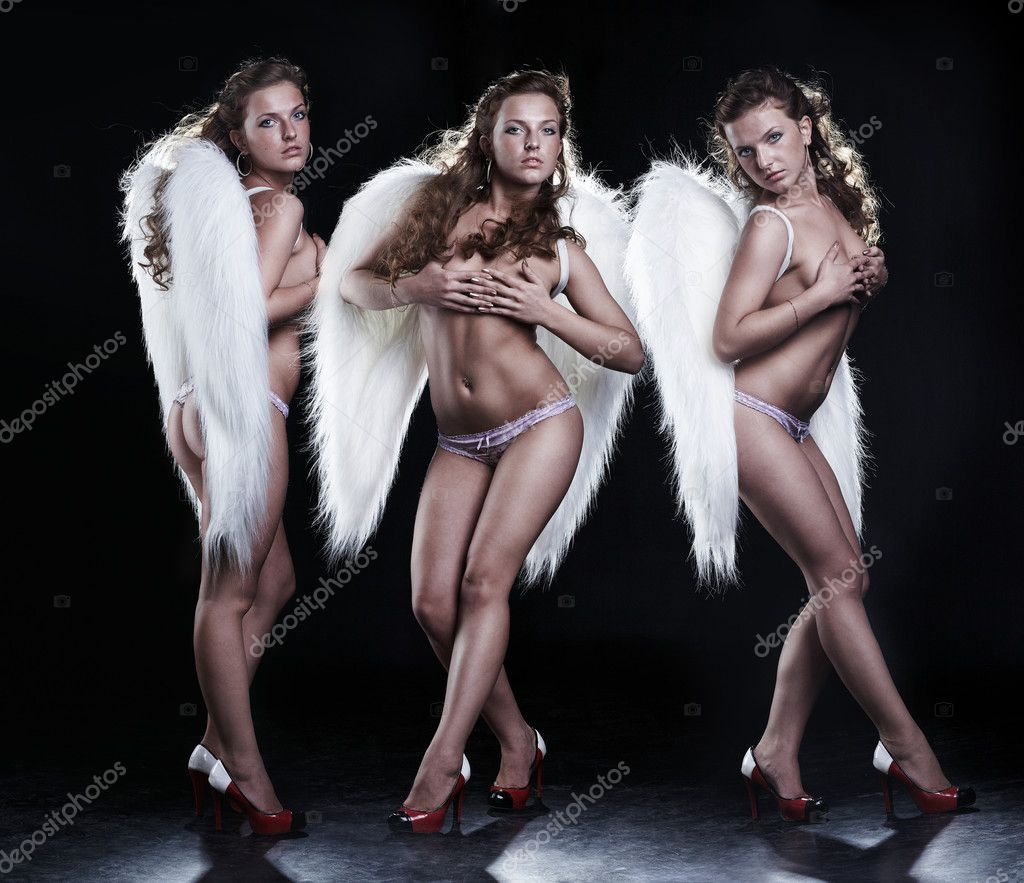 Three beautiful angels on black background — Zdjęcie stockowe #1913557