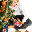 Boy holding christmas present - Stock Photo