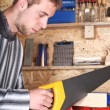 Young male sawing — Stock Photo #1881172
