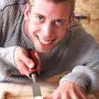 Young smiling carpenter - Stock Photo