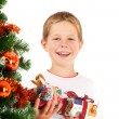 Stock Photo: Young boy and christmas presents