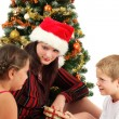 Christmas family with presents - Stockfoto