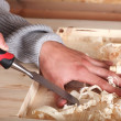 Hands in wood work — Stock Photo