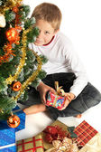 Boy holding christmas present — Stock Photo