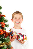 Young boy and christmas presents — Stock Photo