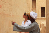Egyptian man and tourist — Stock Photo