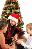 Christmas family with presents — Stockfoto
