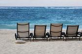 Lounge chairs on beach — Stock Photo