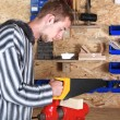 Stock Photo: Young workman with handsaw