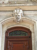Arch door face grinning imp — Stock Photo