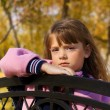 Little girl on the bench — Stock Photo