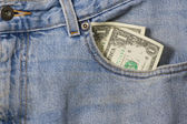 Closeup denim pocket with money — Stock Photo