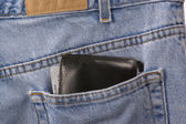 Closeup of denim blue jeans with wallet — Stock Photo