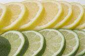 Lime with Lemon Slices — Stock Photo