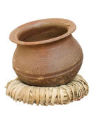 Handmade clay pot on a wicker stand — Stock Photo