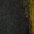 Stock Photo: Black tarmac and yellow road marking
