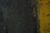 Black tarmac and yellow road marking — Stock Photo