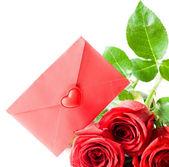 Red envelope and red rose — Stock fotografie