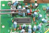 Chip in tweezers — Stock Photo