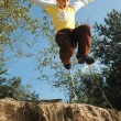 Boy jumps above chasm — Stock Photo #1984286