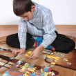 Boy playing puzzle — Stock Photo