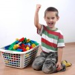 Boy playing with plastic blocks - Stock Photo