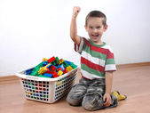 Boy playing with plastic blocks — Stock Photo