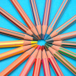 Foto Stock: Circle from coloured pencils
